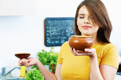 Woman sniff preparing food. Stock Photo