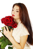 Woman sniffing bouquet Stock Photo