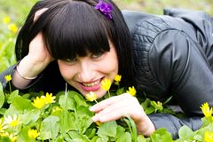 Woman sniffing flowers Stock Photo