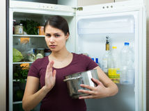Woman sniffing at foul food Royalty Free Stock Photo