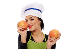 Woman sniffing perfumed grapefruit Royalty Free Stock Photography