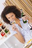 Woman sniffing red wine in glass Stock Photos