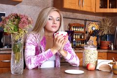 Woman sniffing the scent cup of hot drink Stock Photos