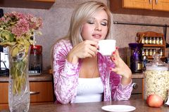 Woman sniffing the scent cup of hot drink Stock Images