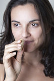 Woman sniffing on wine cork Stock Photography