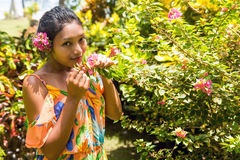 Woman sniffs a flower Stock Photography