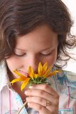 Woman sniffs sunflower Royalty Free Stock Photo