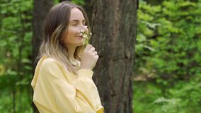 Woman sniffs wildflowers. Calmness and unity with nature