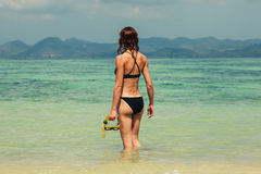 Woman with snorkel on the beach Stock Photography