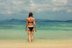 Woman with snorkel on the beach Stock Image