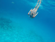 Woman with snorkel in the blue sea Stock Photography
