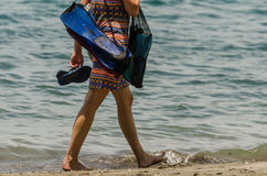 Woman with snorkel equipment on the beach Royalty Free Stock Images