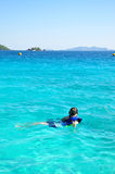 Woman with snorkel on ocean Stock Photo