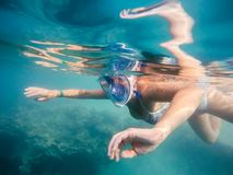 Woman snorkel in shallow water Stock Photo