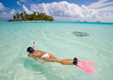 Woman snorkeler. Woman free diving in beautiful blue lagoon Royalty Free Stock Images