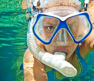 Woman snorkeling. Young woman underwater with snorkeling mask and tube stock photos