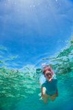 Woman snorkeling Stock Image