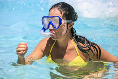 Woman snorkeling on the beach Stock Images