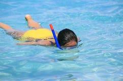 Woman snorkeling on the beach Stock Photos