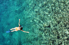Woman snorkeling in crystal clear tropical water. Woman snorkeling in crystal clear tropical sea water Stock Images