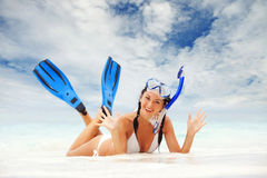 Woman with snorkeling equipment on the beach Royalty Free Stock Images