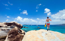 Woman with snorkeling equipment at tropical beach Stock Photography