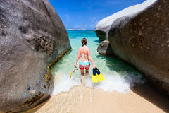 Woman with snorkeling equipment at tropical beach Royalty Free Stock Image