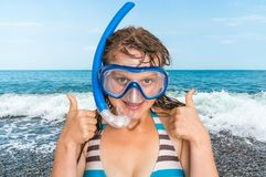Woman with snorkeling mask for diving stands near the sea Stock Images