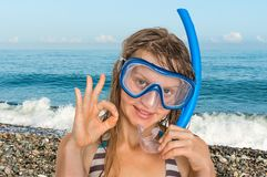 Woman with snorkeling mask for diving stands near the sea Stock Image