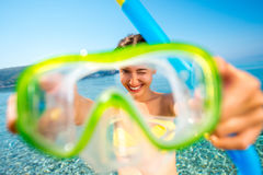 Woman with snorkeling mask on the sea background Stock Photography