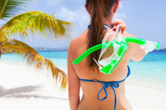 Woman with snorkeling mask at tropical beach Stock Photos