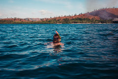 Woman snorkeling near tropical island Royalty Free Stock Photo