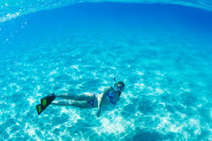 Woman Snorkeling in Tropical Ocean Royalty Free Stock Image