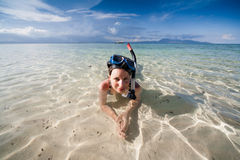 Woman snorkeling in the tropical sea Stock Photo