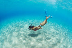 Woman snorkeling in tropical sea Royalty Free Stock Photos