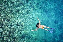 Woman snorkeling in tropical sea water stock photo