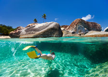 Woman snorkeling in tropical water Stock Image