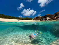 Woman snorkeling at tropical water Royalty Free Stock Photo