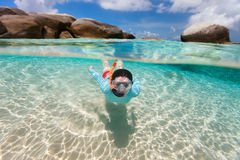 Woman snorkeling in tropical water Stock Photo