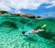 Woman snorkeling in tropical water Royalty Free Stock Photos