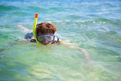 Woman snorkeling in tropical waters Royalty Free Stock Photo