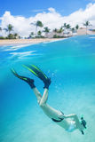 Woman snorkeling underwater at a tropical island resort Stock Photo