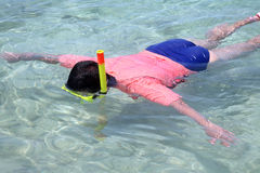 Woman snorkelling Stock Images