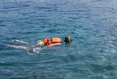 Woman snorkelling in andaman sea at phi phi islands, Thailand royalty free stock photo