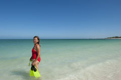 Woman snorkelling at tropical beach Stock Images
