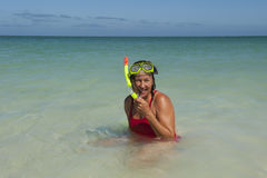 Woman snorkelling at tropical beach Royalty Free Stock Photo