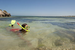 Woman snorkelling at tropical beach Stock Photo