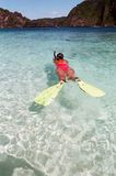 Woman snorkels in clear and turquoise water. Photos taken in philippines Stock Images