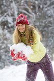 Woman with snow. Portrait of beautiful woman holding snow and smiling Stock Image