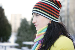 Woman in Snow. Beautiful brunetka winter on the street looks into the distance Royalty Free Stock Photo